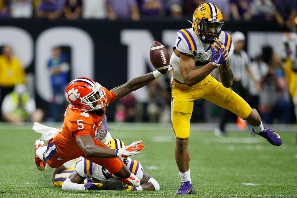 LSU safety Grant Delpit, right, breaks up a