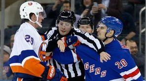 Linesman Libor Suchanek tries to separate Brock Nelson