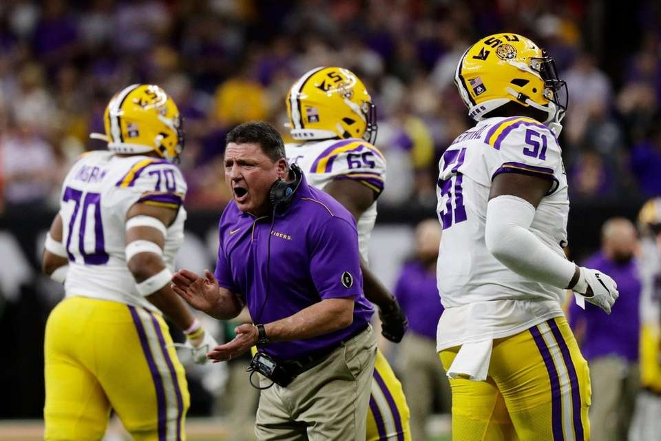 LSU head coach Ed Orgeron cheers during the