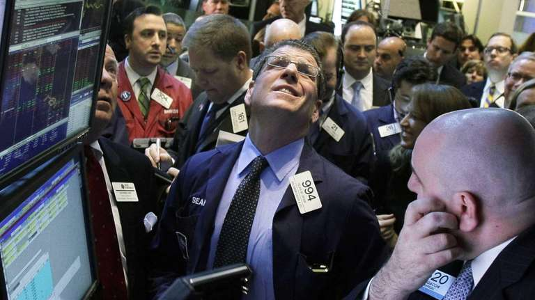 Traders check the prices to begin trading on