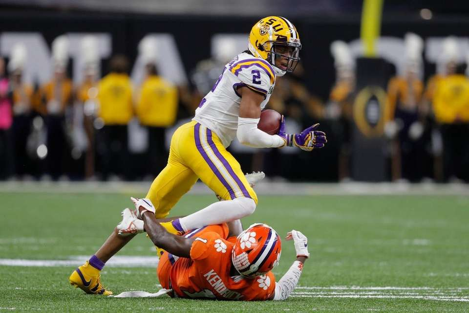 LSU wide receiver Justin Jefferson runs over Clemson