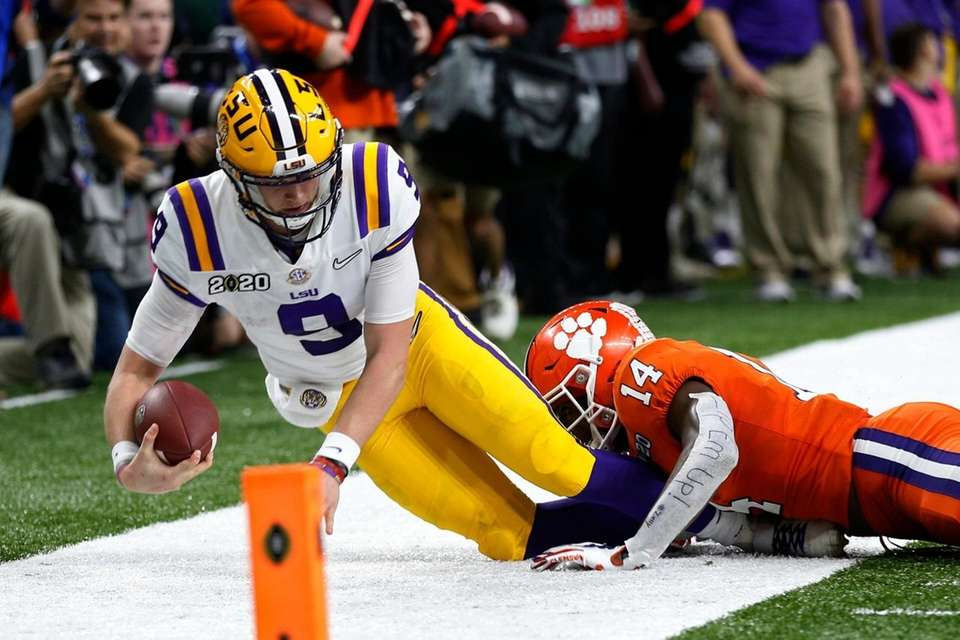 LSU quarterback Joe Burrow is tackled by LSU