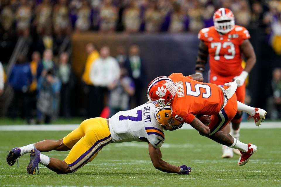 Clemson wide receiver Tee Higgins is tackled by