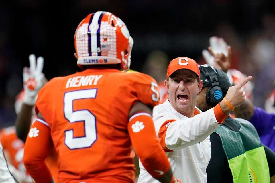 Clemson head coach Dabo Swinney yells to Clemson