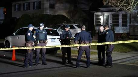 Police investigated a shooting in front of a