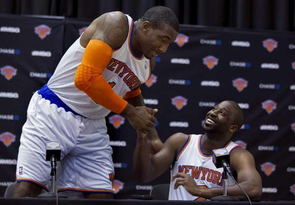 The Knicks' Amar'e Stoudemire, left, shakes hands with