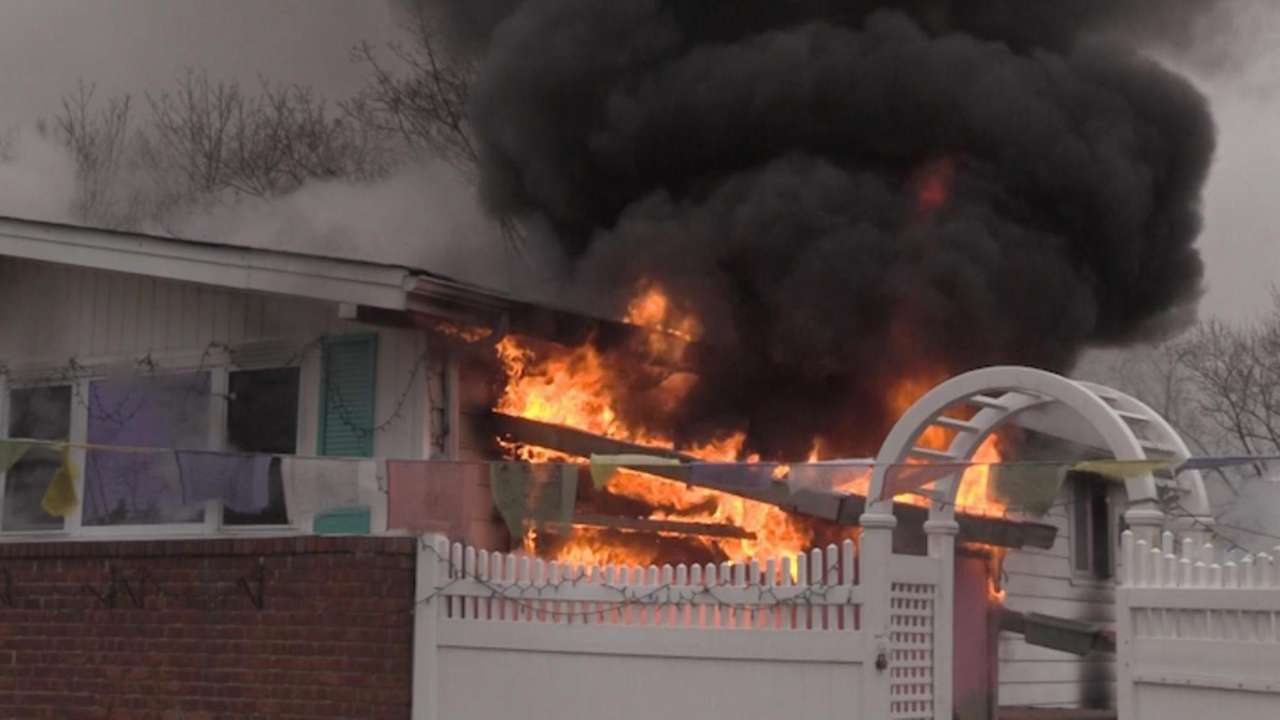 Firefighters from at least seven Suffolk County departments