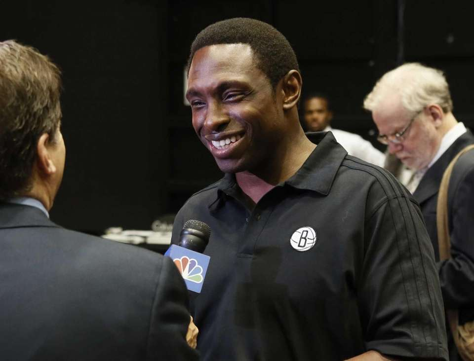 Brooklyn Nets basketball coach Avery Johnson is interviewed