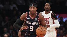Knicks guard RJ Barrett dribbles the ball against