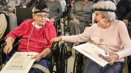 Rosa Aquino, 101, left, and Dorothy Hunter, 105,