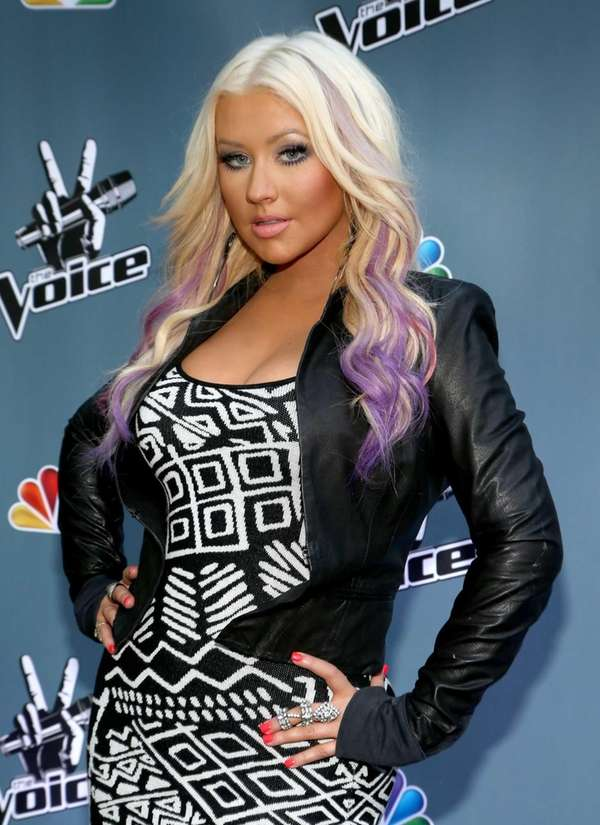 Christina Aguilera attends a promotional event for