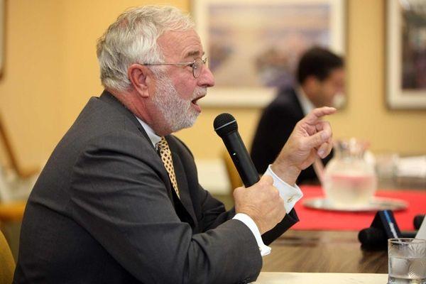 Tim Bishop speaks during a debate with Randy