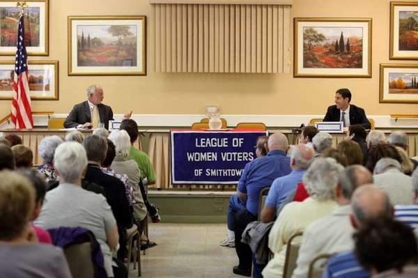 Tim Bishop, left, and Randy Altschuler debate at