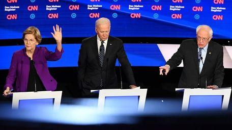 Elizabeth Warren, Joe Biden and Bernie Sanders at