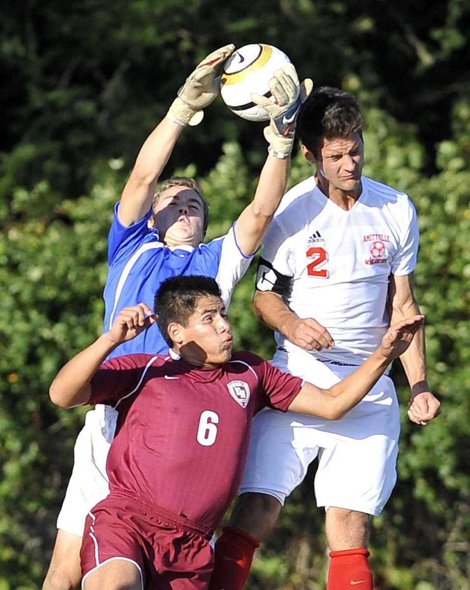 East Hampton goalkeeper Nick Tulp makes a save