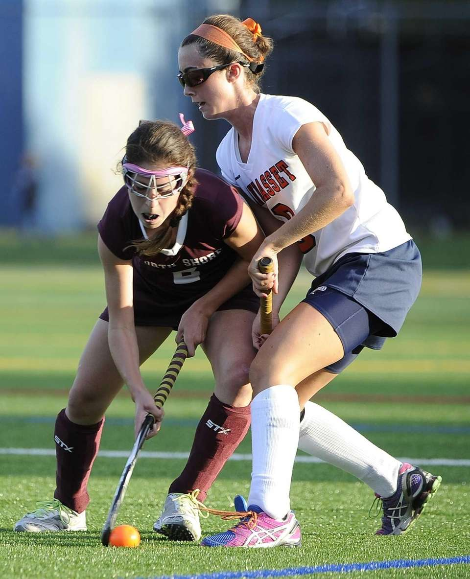 Manhasset's Julia Glynn defends against North Shore's Maddi