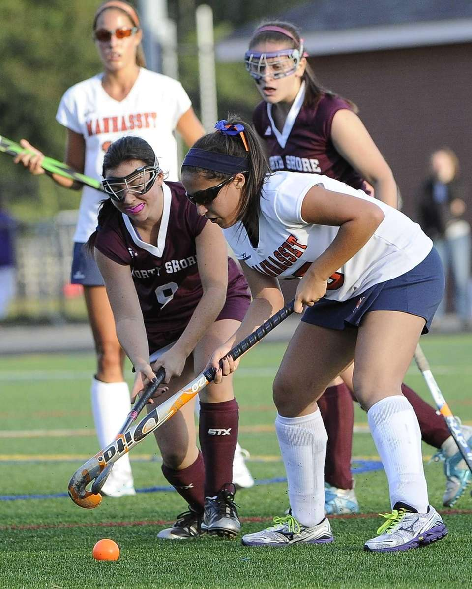Manhasset's Jacqueline Bruno battles for possession with North