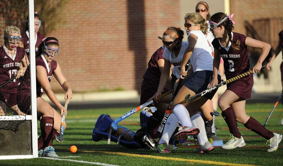 North Shore's Carly Comitino saves a shot on