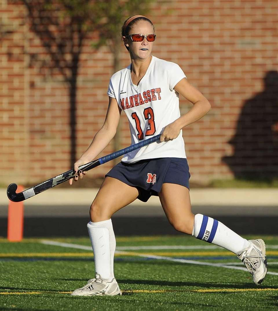 Manhasset's Madison Molinari follows her pass against North