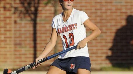 Manhasset's Madison Molinari follows her pass against North
