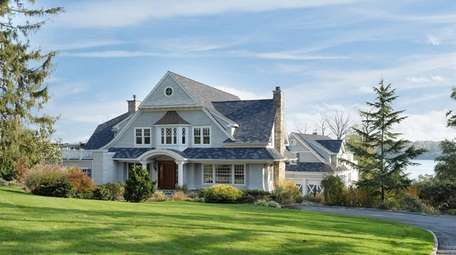 This six-bedrooms, 6½-bath Colonial in Sands Point is