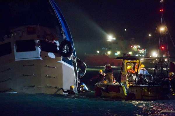 Rescue crews search for passengers in waters near