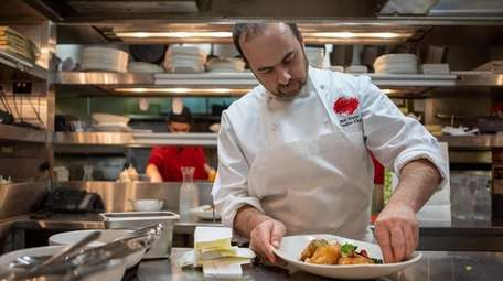 Chef Jack Grace prepares Vietnamese dishes at Monsoon