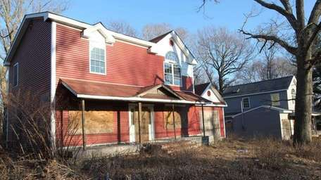 Abandoned properties at 77 and 81 W. Main