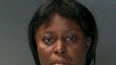 Bridget Erwat, 49, of Amityville, was arrested by