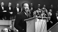The Rev. Martin Luther King Jr. addresses the