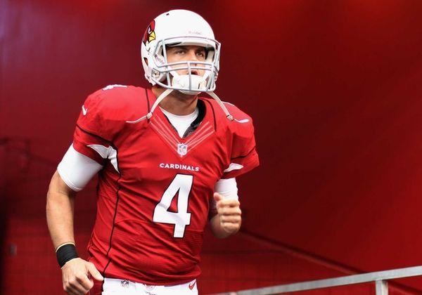 Arizona Cardinals quarterback Kevin Kolb runs out onto