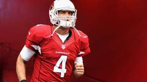 Arizona Cardinals quarterback Kevin Kolb runs out onto