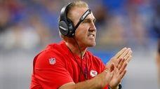 Kansas City Chiefs defensive coordinator Steve Spagnuolo signals