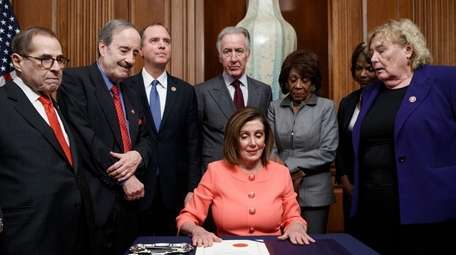 Speaker of the House Nancy Pelosi, with committee