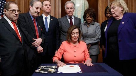 House Speaker Nancy Pelosi on Wednesday signs the