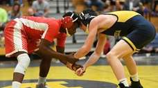 Massapequa's Jack Kirschbaum, right, wrestles Freeport's Jerry Ellis