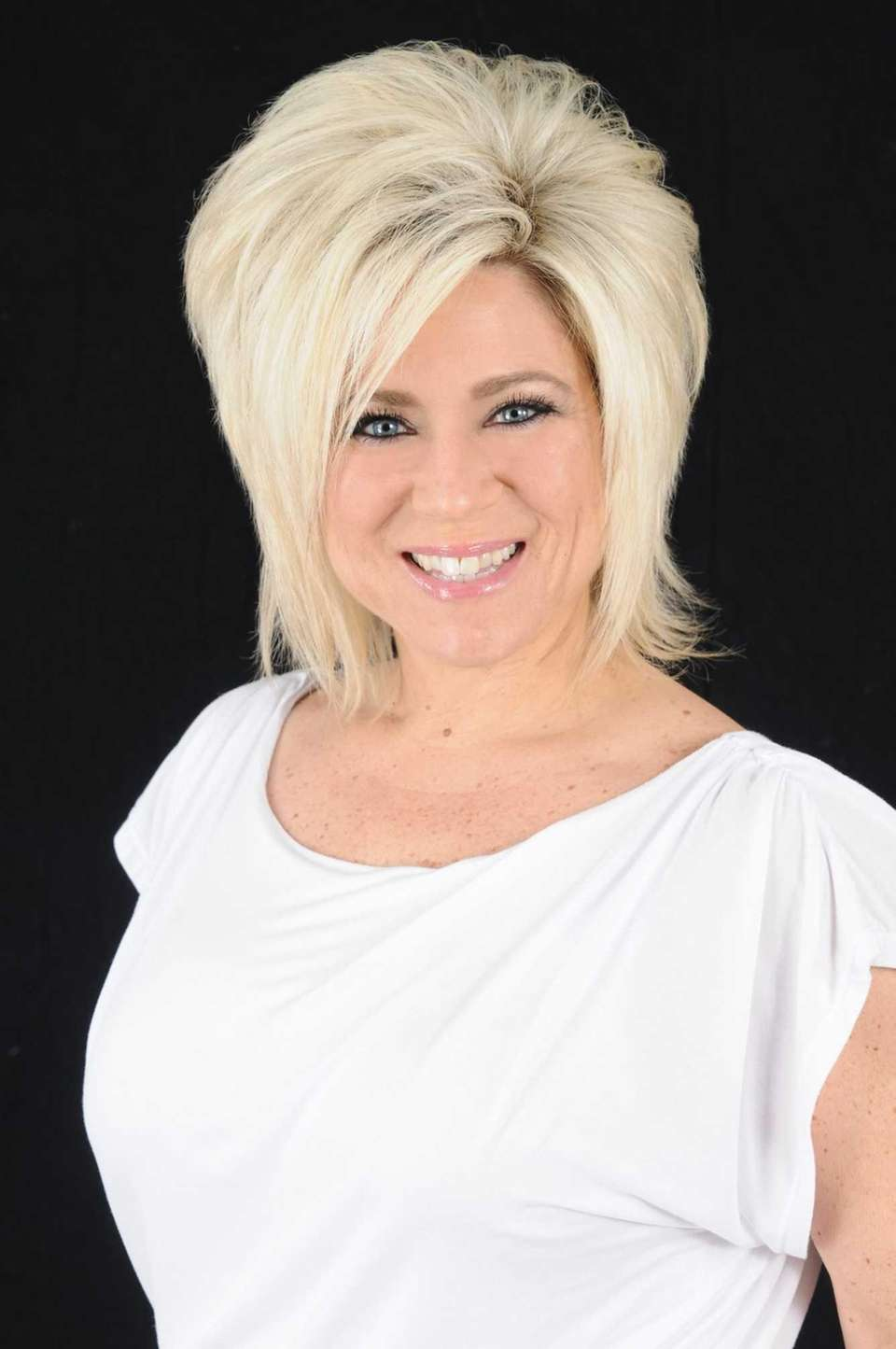 Theresa Caputo, who was born and raised in