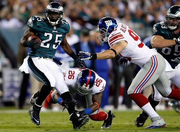 Eagles running back LeSean McCoy is tackled by