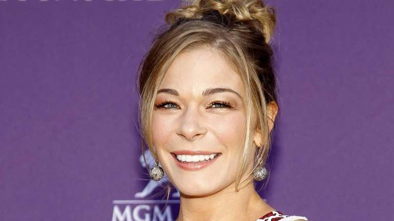 Country singer and LeAnn Rimes arriving at the
