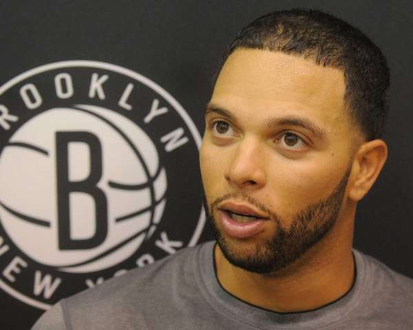 Deron Williams talks to the media after team