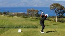 Jason Day of Australia plays his shot from