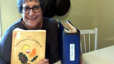 Linda Maryanov with her Moosewood cookbook and her