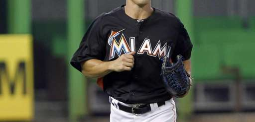 Miami Marlins' Adam Greenberg heads to the dugout