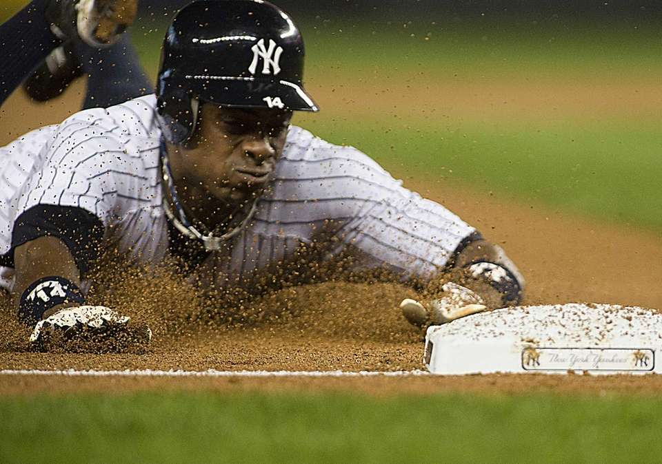 Curtis Granderson slides into third for a stolen
