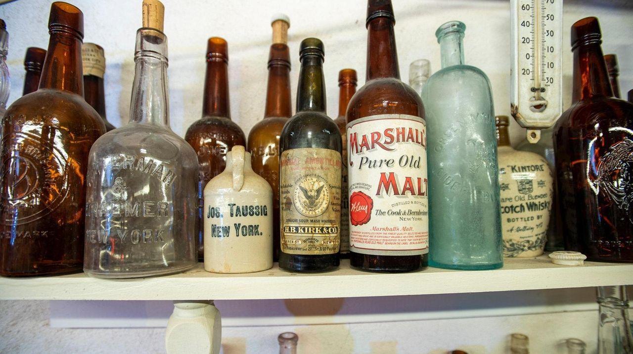 Long Island Antique Bottle Association co-chair Mark Smith