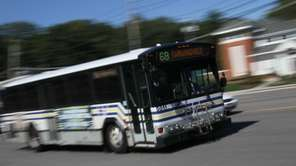 A Suffolk Transit bus travels on Route 25