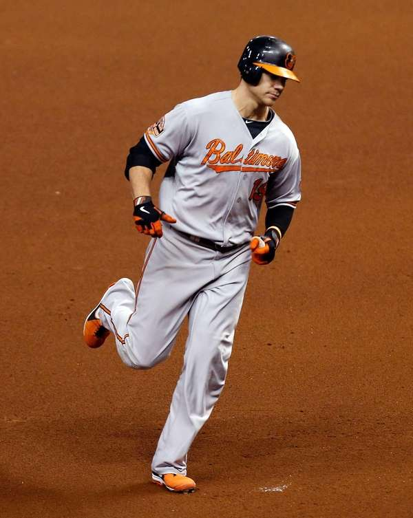 Orioles outfielder Chris Davis rounds the bases after