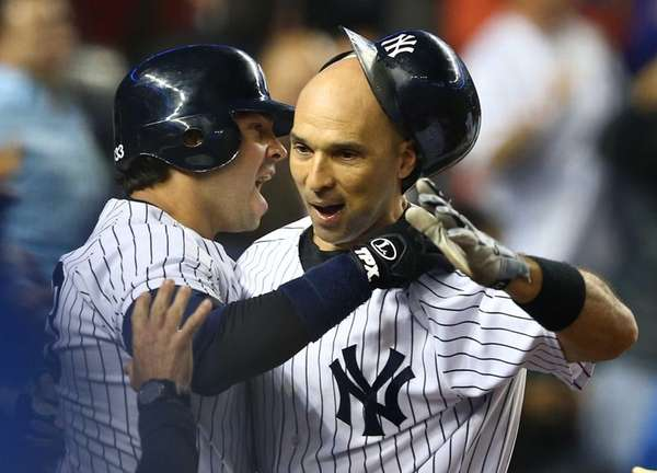 Raul Ibanez celebrates his game-tying home run with