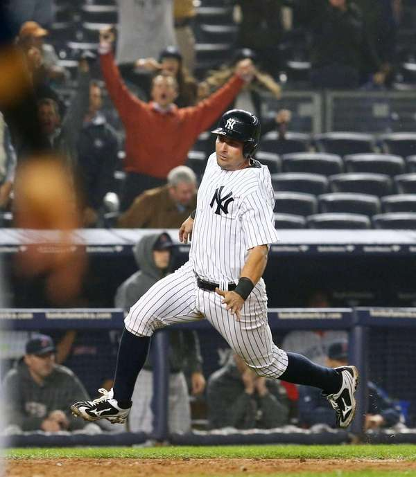 Francisco Cervelli scores the game-winning run in the