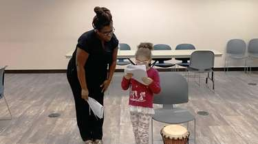 Kelly Boston-Hill, 5, of West Hempstead, rehearses with